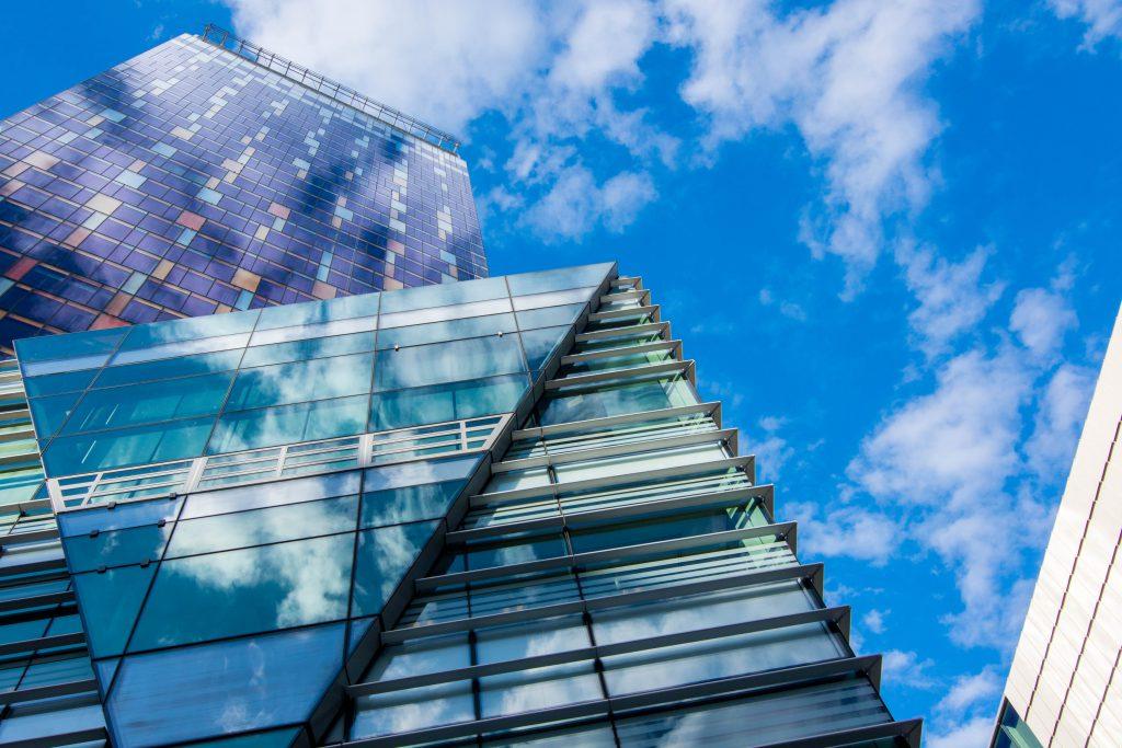 glass-building-panels-under-blue-sky-691452
